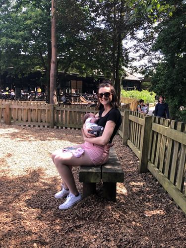 Sophie breastfeeding her little one at the park