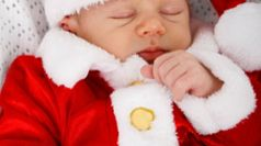 new-born-baby-dressed-in-christmas-outfit